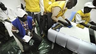 Workers sort ballots in Salva Kirr School, in Aweil, Northern Bahr El-Ghazal